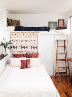 What a way to work a small space. Love this dual bed set up Moroccan Wedding Blanket Headboard | Remodelista