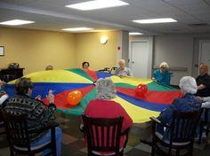 Parachute games using balloons