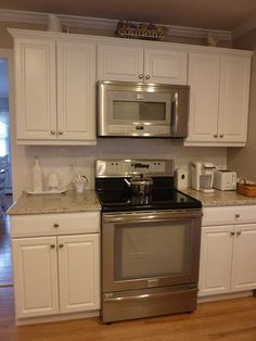 These are the exact same cupboards we have in our townhouse now. We are thinking of repainting the cupboards in the new place to look just like them. Instead of the horrible black paint job on them now.