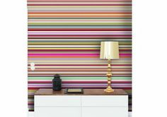 I'm all for accent walls and bold colour. Here's a multi-coloured striped wall. LOVE.