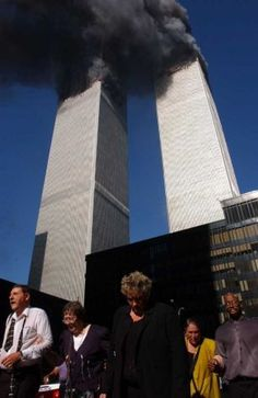 NEW YORK - SEPTEMBER 11, 2001: Civilians flee the area as a tower of the World Trade Center collapses after two airplanes slammed into the twin towers in an alleged terrorist attack September 11, 2001 in New York City. This September 11 marks ten years since members of Al Qaeda hijacked four planes, attacking the World Trade Center and the Pentagon and crashing one in Shanksville, Pennsylvania, killing nearly 3,000 people in all. The effects continue to resonate across the global political…