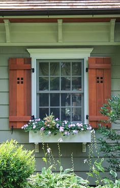 Craftsman Style window w shutters and flower box.