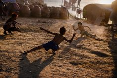 Look at children playing..  You'll understand that there are much more happy people on this planet. Feel the balance of powers? We always have hope. -- Vs. (pic by Steve McCurry)