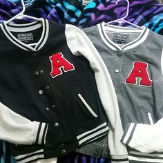 "Cute lettr jackets 2 for $20 on these or $15 each. The one on the left: black with grey sleeves & a red ""A"". The one on the right: light grey, white sleeves, red ""A"" ive worn each of these maybe twice? Jackets & Coats"
