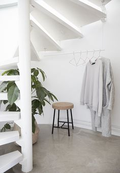 Spiral stairs and cloakroom with a SINNERLIG stool in a delightful home in Finland / Riika Kantinkoski
