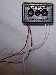"""an MTC Master Tone Circuit, made for me by John """"Dawk"""" Stillwell, of """"Dawk Sound Limited""""  back in May of 2007.  Mr. Stillwell worked with Deep Purple as a technician as well as working with Ritchie Blackmore's guitar sound during parts of the 1970's and 80's.  In my reading of the history of Mr. Stillwell, Blackmore's gear was modified by him including his Marshall Majors and his Fender Stratocasters. Dawk designed the Master Tone Circuit that was installed in Blackmore's guitars."""