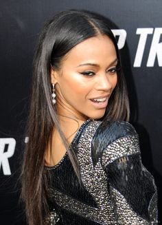 Actress Zoe Saldana parades on the red carpet