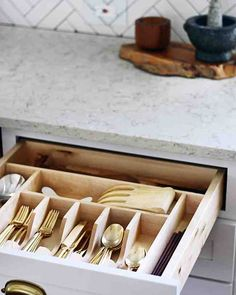 Clutter-Free Drawers - Drawer organizers are essential for taming your utensils.