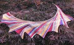 Illegal Triangles knitting pattern so called because knitting them is so much fun they should be illegal! You can find the pattern on Ravelry. Just look for Lynn Venghaus' designs. Self Striping sock yarn or one Crazy Zauberball.