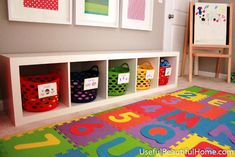 Using white single row cube storage for a low shelf for kid toys (multicolored bins)