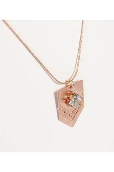 Colgante en oro rosa y Swarovski  www.tenestilo.com