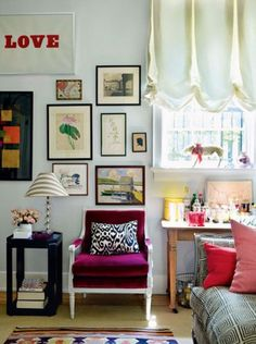 Wall collage, velvet chair, patterns, colors, bar table...everything except the roman shade...don't like that.