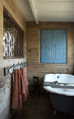 bathroom:  not the style but the elements 1. tub storage items (soap, bubble bath, etc) on wall above -  with or without doors 2. hooks on wall at waist height for towel and clothes 3. tub running parallel with not perpendicular to cubby