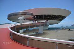 Museu de Arte Contemporânea (MAC) - Art Contemporary Museum - Museu de Arte Contemporânea (MAC - Niterói - RJ)  Projetado pelo arquiteto Oscar Niemeyer, o MAC tornou-se um dos cartões-postais de Niterói. Destina-se principalmente a obras pertencentes à arte contemporânea, todas datadas ao decorrer do século 20. ............................................................ Museum of Contemporary Art (MAC – Brazil / RJ / Niterói). Designed by architect Oscar Niemeyer, the MAC has become one of…