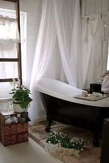 love this, really like the brick under the tub. The curtains, and the ladder for holding towels or magazines