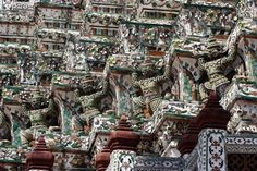 Wat Arun - This temple is considered to be the most famous and photographed temple in Bangkok, which features a soaring 70-meter-high spire decorated with tiny pieces of colored glass and Chinese porcelain.
