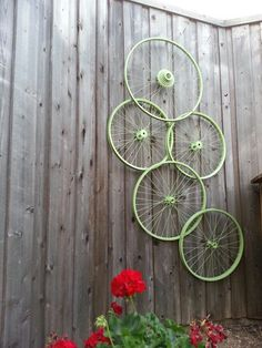 My recycled bike wheel trellis! I have morning glory seedlings started at the base :-) can't wait until they bloom!