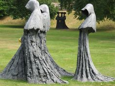 Sculptures by Philip Jackson, pictured during his one man exhibition Sacred and Profane, at the Bishop's Palace in Wells, Somerset. In the foreground is Cloister Conspiracy, while in the distance is Serenissima.