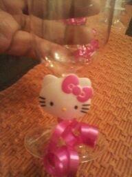 Plastic wine glasses personalized with a cupcake ring and ribbon.