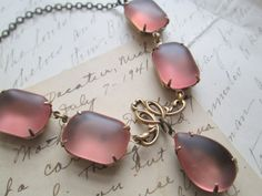 Collete.  vintage pink beach glass rhinestone by SacredCake, $59.00 SacredCake makes the prettiest things!!!!