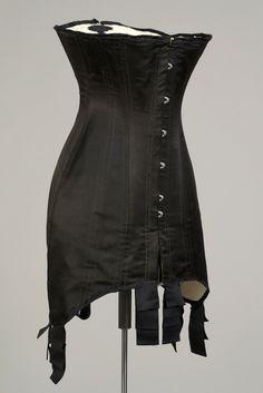 Corset. American, ca. 1910. Black silk with steel boning