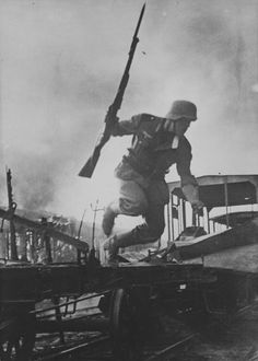 Wehrmacht soldier jumping onto a railway platform during the Battle of Smolensk in 1941.