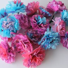 Make colorful Coffee Filter Flowers for Spring decor! Easy to make and very inexpensive!