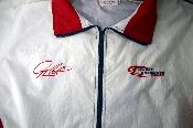 Authentic vintage Penske Kranefuss Racing Mobil One windbreaker. Nice, heavy windbreaker with a zipper and the Penske Kranefuss logo.