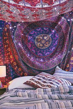 A gorgeous 100% cotton hand printed tapestry featuring a center Mandala with round circle rings in 6 different colors. Tapestry tablecloth
