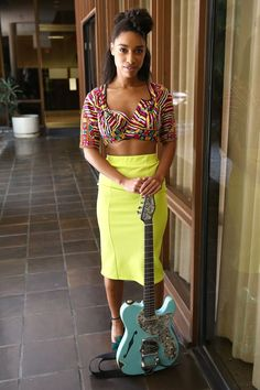 """Pin for Later: Lianne La Havas's Style Is Unstoppably Cool Posing backstage at the Warner Bros. """"Summer Sessions"""" in California July 2014, Lianne wore an embroidered crop with acid-green pencil skirt."""