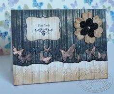A card with black background, butterflies and perfect pearls.