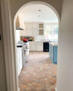 Tell me - are you as in love with this arched doorway as we are? Kitchen Island, Kitchen Cabinets, Doorway, This Is Us, Kitchen Design, Studio, Home Decor, Island Kitchen, Entrance