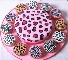 Animal Print Cake and Cupcakes. Black and white cheetah, tan and brown cheetah, and zebra. It looks like fondant, but I'm so going to try this!
