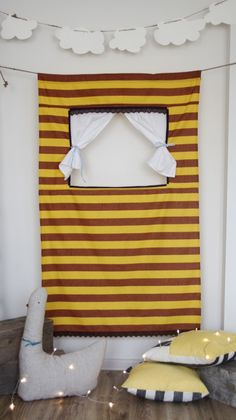 Doorway puppet theatre - another example, in front of a door is not necessarily required. Can be hung in the corner of a room.  Vrindavan village ideas