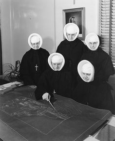 Sisters of Providence reviewing plans for new wing, Providence St. Vincent Medical Center, Portland, Oregon, c. 1956