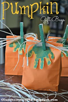 Pumpkin Gift Bags - Handprints as the leaves Are you kidding me right now? These are adorable!