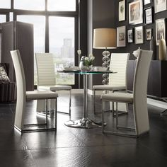 The Caley Collection dining set features a contemporary design with a tempered glass table top surface that transitions. The table is lifted on a neutral chrome base that furthers the table's modern inventive design.