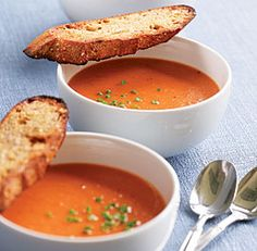 Classic Tomato Soup -- In a nonreactive 5- to 6-quart Dutch oven, heat the oil and butter over medium-low heat until the butter melts. Add the onion and garlic and cook, stirring occasionally, until soft but not browned, about 8 minutes. Add the flour and stir to coat the onion and garlic.