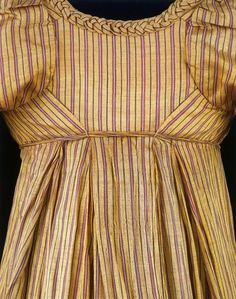 The cut of this silk dress was very fashionable during the early 1800s. It complemented the simple lines of the high-waisted dresses and cre...