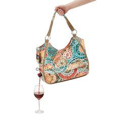 Bring happy hour to go with this fashionable tote, offering an insulated bag and spout for easy serving.