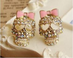 These earrings incorporate two of my loves: skulls and bows!