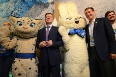 Russian deputy Prime minister Dmitry Kozak, centre, and Russian Olympic Comittee president Alexander Zhukov pose next to Sochi 2014 Winter Olympic games mascots. (Photo by Kirill Kudryavtsev/AFP/Getty Images)