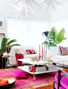pops of fuschia with all white furniture