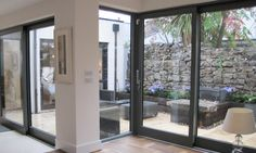 Wrap window around corner in kitchen ? RTÉ Television - Room to Improve : Munster Joinery & Mulcon Construction Munster Joinery, Sliding Glass Door, Glass Doors, Sliding Doors, Space Interiors, Bedroom Interiors, Contemporary Front Doors, Mews House, House Extensions