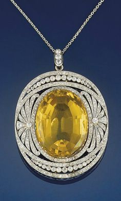 I'd love this with a sapphire  shewhoworshipscarlin: Citrine and diamond necklace, 1905.