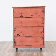 This shabby chic highboy dresser is featured in a solid wood painted in a distressed light red chalk paint. This tall dresser is in great condition with 4 large drawers and tapered mid century modern feet. Unique storage piece!   #shabbychic #dressers #talldresser #sandiegovintage #vintagefurniture