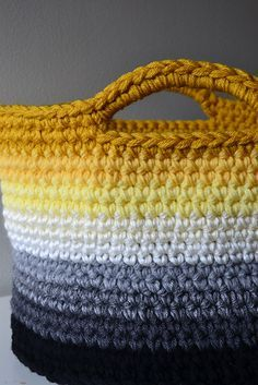 A bigger basket than the chunky yarn version.  This one takes four strands of worsted weight yarn.