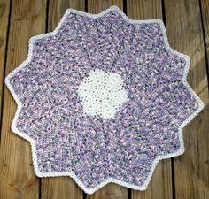 I did not like the previous round ripple I was crocheting because the points were almost the same size.  I started another and I like the si...