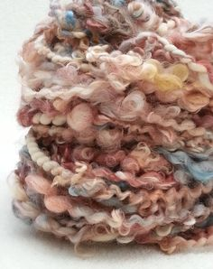 Teeswater Wensleydale lock hand spun art yarn with buttermilk merino & bamboo by Pinkipunki, £51.00 on Etsy at http://www.etsy.com/listing/160435283/teeswater-wensleydale-lock-hand-spun-art