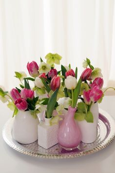Spring - Small vases with tulips and Helleborus niger